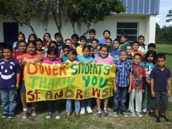 "Group of Dover Elementary students holding a ""thank you St. Andrews"" banner"